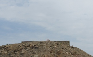 People exploring ruins atop Telegraph Island