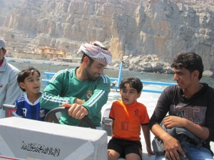 Kumzari man and his sons who took us back to our dhow