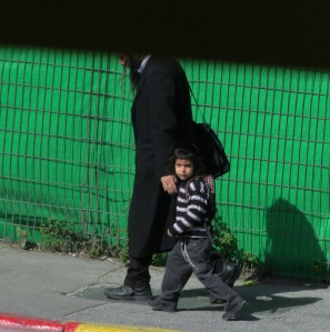 Orthodox Jewish man and his son