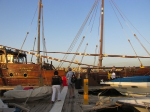 heading along the dock to the dhow
