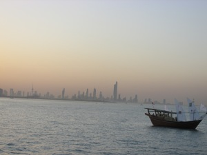This is a smaller dhow, but sort of what we looked like on the water with the city in the background.