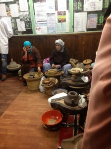 Women shelling argon seeds in the pharmacy.