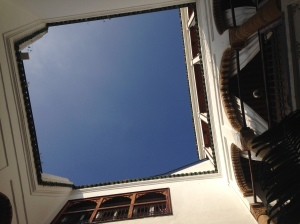 Looking directly up while sitting in the courtyard, which is open to the outdoors
