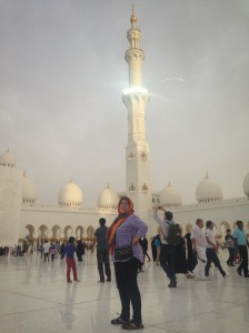 me in the courtyard with a minaret in the back