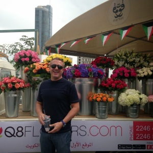 My friend, Thom, standing in front of a gorgeous flower stall