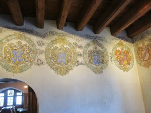crests painted on the wall in the castle