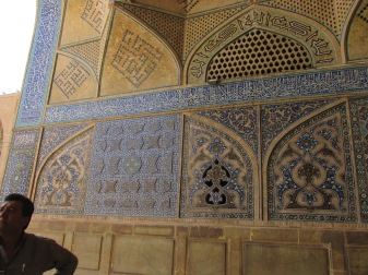 Here is more of the tiles. Most of this has writing on it, but it still looks so decorative. In the corner is Ali, our guide.
