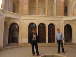Our guide Ali (left) and Glenn looking up from a courtyard