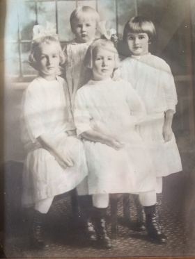 History: My grandmother is the sister with dark hair on the right