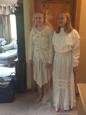 My nieces in my grandmother's (L, Mikayla) and great-grandmother's (R, Kaleah) wedding gowns.